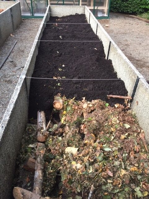 Third, add manure on top of the leaves.